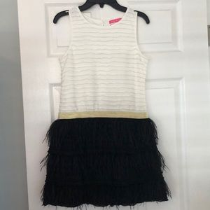 Girls faux feathered dress. Never worn but no tags